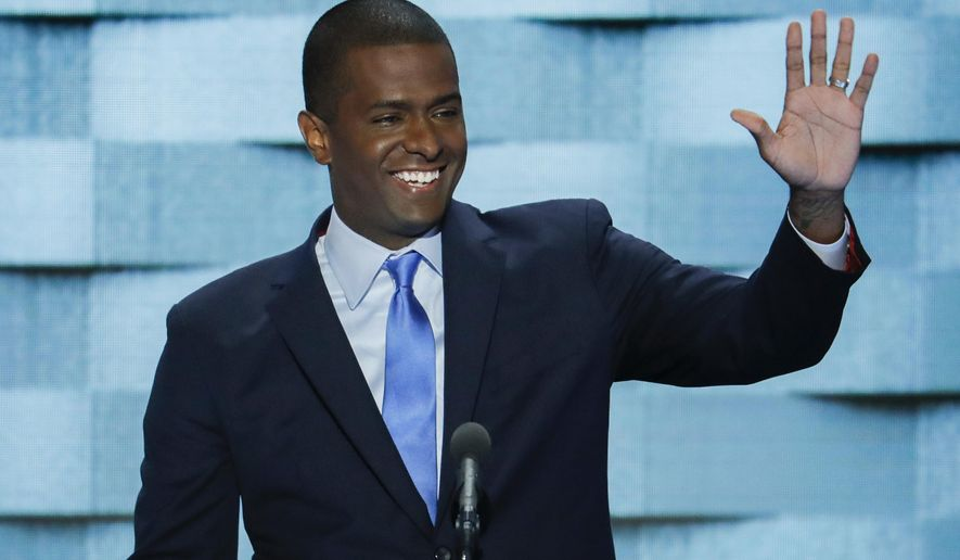 FILE -  Int his July 28, 2016, file photo, former state Rep. Bakari Sellers, D-SC., speaks during the final day of the Democratic National Convention in Philadelphia. Sellers planned to play Santa Claus in his hometown of Denmark on Friday, Dec. 23, 2016, giving away thousands of dollars in toys, books and bikes to kids in need and using social media to help do it(AP Photo/J. Scott Applewhite, File)