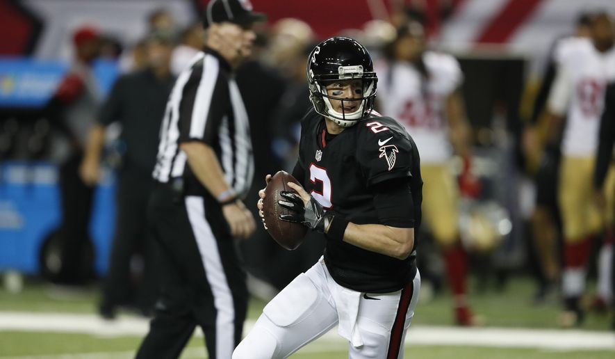 FILE - In this Sunday, Dec. 18, 2016 file photo, Atlanta Falcons quarterback Matt Ryan (2) runs out of the pocket against the San Francisco 49ers during the first half of an NFL football game in Atlanta. The Atlanta Falcons play the Carolina Panthers on Saturday, Dec. 24, 2016. (AP Photo/John Bazemore, File)