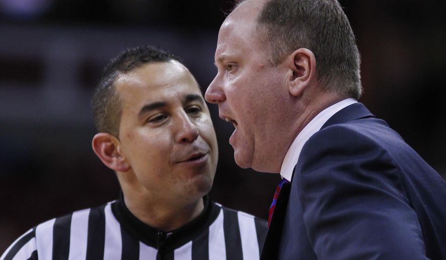 Wisconsin coach Greg Gard talks with official Larry Scirotto during the second half of the team's NCAA college basketball game against Florida A&M Friday, Dec. 23, 2016, in Madison, Wis. Wisconsin won 90-37. (AP Photo/Andy Manis)