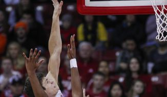 Wisconsin's Ethan Happ, behind, shoots against Florida A&M's Derrick Dandridge (14) during the first half of an NCAA college basketball game Friday, Dec. 23, 2016, in Madison, Wis. (AP Photo/Andy Manis)