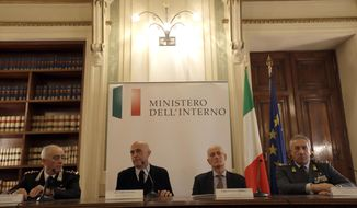 "Italian Interior Minister Marco Minniti, second from left, is flanked by Rome's prefect Franco Gabrielli, second from right, Carabinieri commander General Tullio del Sette, left, and Financial Police commander general Giorgio Toschi, right, during a news conference in Rome, Friday, Dec. 23, 2016. Italy's interior minister Marco Minniti says the man killed in an early-hours shootout in Milan is ""without a shadow of doubt"" the Berlin Christmas market attacker Anis Amri. (AP Photo/Gregorio Borgia)"