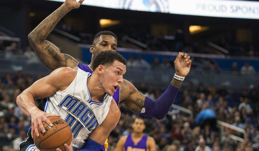 Orlando Magic forward Aaron Gordon (00) rebounds the ball in front of Los Angeles Lakers forward Thomas Robinson during the first half of an NBA basketball game in Orlando, Fla., Friday, Dec. 23, 2016. (AP Photo/Willie J. Allen Jr.)