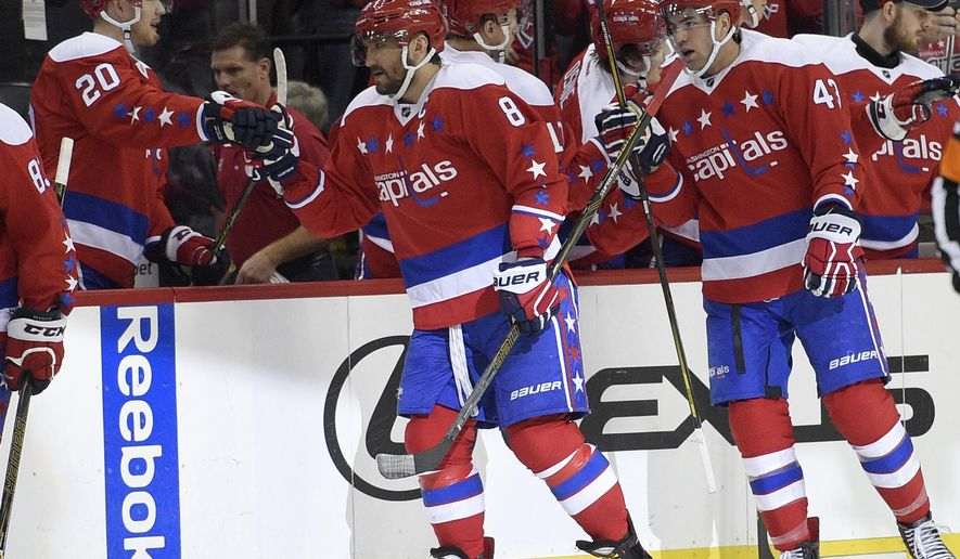 Washington Capitals left wing Alex Ovechkin (8), of Russia, celebrates his goal with center Lars Eller (20), of Denmark, and others during the second period of an NHL hockey game against the Tampa Bay Lightning, Friday, Dec. 23, 2016, in Washington. (AP Photo/Nick Wass)