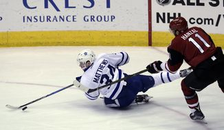 Toronto Maple Leafs center Auston Matthews (34) gets checked by Arizona Coyotes center Martin Hanzal during the second period during an NHL hockey game, Friday, Dec. 23, 2016, in Glendale, Ariz. (AP Photo/Rick Scuteri)