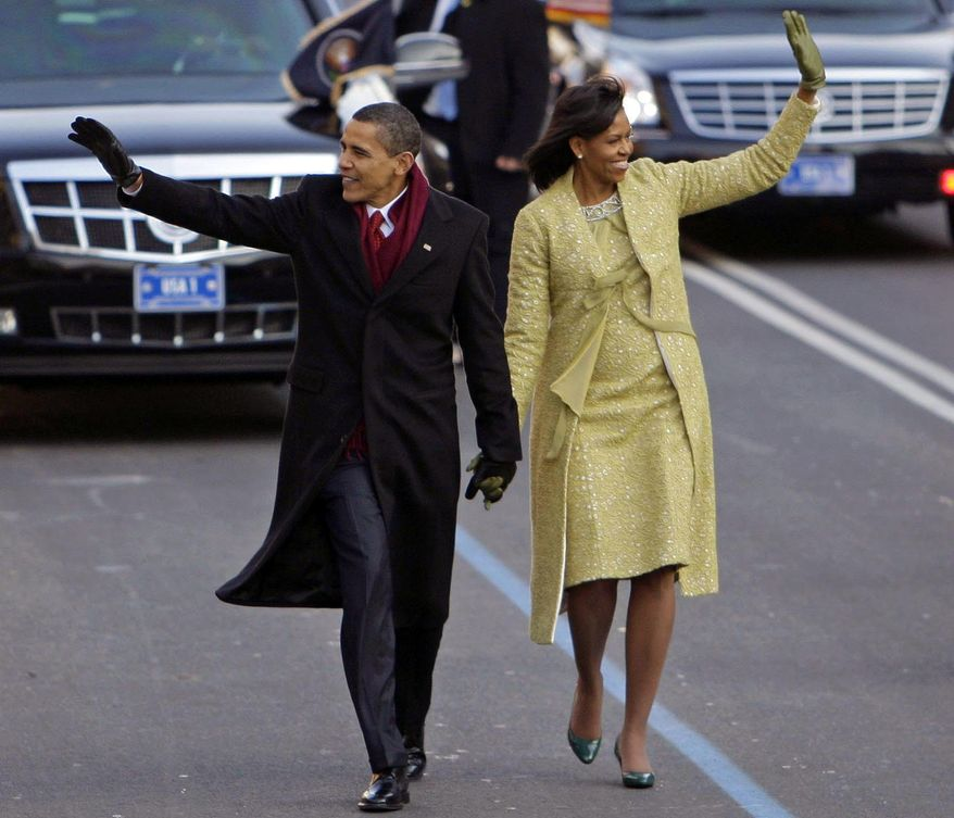 FILE - This Jan. 20, 2009, file photo shows President Barack Obama with first lady Michelle Obama on their way to the White House in Washington. Michelle Obama set the stage for her broad-based fashion choices with her first inauguration. Previous first ladies had often gone with established luxury designers like Oscar de la Renta. Obama wore a two-piece lemongrass-hued ensemble by Cuban-American designer Isabel Toledo. (AP Photo/Alex Brandon, File)