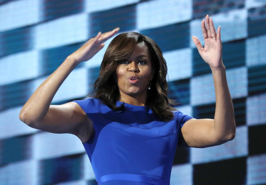 FILE - In this July 25, 2016, file photo, first lady Michelle Obama blows kisses after speaking to delegates during the first day of the Democratic National Convention in Philadelphia. When Michelle Obama considered the daunting prospect of becoming first lady, she purposely avoided turning to books by her predecessors for guidance. Instead, she turned inward (AP Photo/Carolyn Kaster, File)