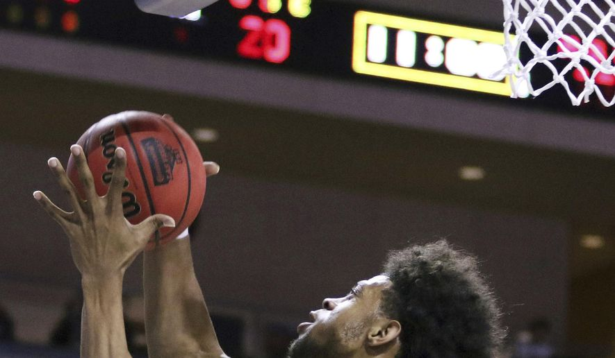 Missouri State's Obediah Church grabs a rebound during the first half of an NCAA college basketball game against Southern California on Thursday, Dec. 22, 2016, in Las Vegas. (AP Photo/Ronda Churchill)