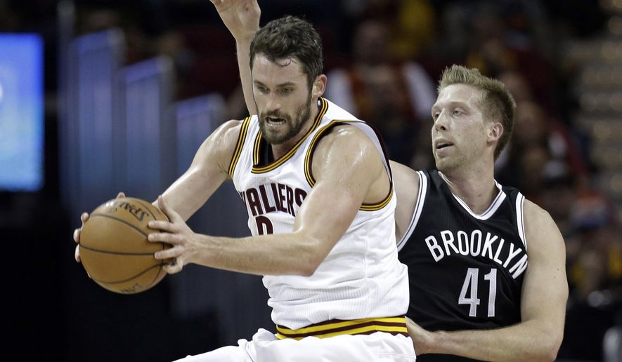 Cleveland Cavaliers' Kevin Love (0) grabs a pass against Brooklyn Nets' Justin Hamilton (41) in the first half of an NBA basketball game, Friday, Dec. 23, 2016, in Cleveland. (AP Photo/Tony Dejak)