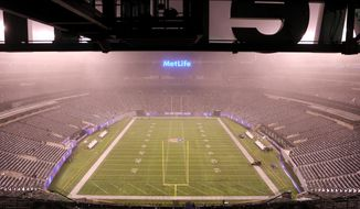 This Sunday, Dec. 18, 2016 photo provided by MetLife Stadium shows the field at MetLife Stadium in East Rutherford, N.J. The biggest challenges at the New Jersey Meadowlands last weekend probably didn't belong to the Giants and Jets. Instead, it was the folks charged with getting MetLife Stadium ready for a Saturday night Dolphins-Jets game and an early afternoon Lions-Giants contest the next day.  (MetLife Stadium via AP)
