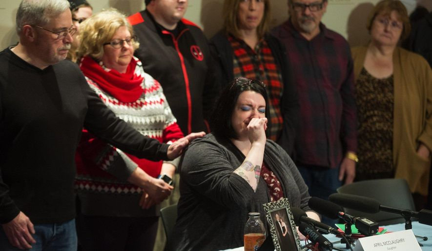 April McClaughry, daughter of Mount Vernon Officer Mike McClaughry, speaks at a news conference at Harborview Medical Center in Seattle on Friday, Dec. 23, 2016, to discuss her father's condition. Mike McClaughry was shot in the head while responding to a call last week . (Ellen M. Banner/The Seattle Times via AP)
