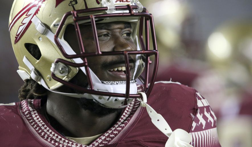 FILE  In this Nov. 11, 2016 file photo, Florida State's Dalvin Cook smiles as he prepares to play Boston College in an NCAA college football game in Tallahassee, Fla. Cook has had his share of great games at Hard Rock Stadium. The Miami native could be playing in his final college game there on Dec. 30 when the 10th-ranked Seminoles face No. 6 Michigan in the Orange Bowl. (AP Photo/Steve Cannon)
