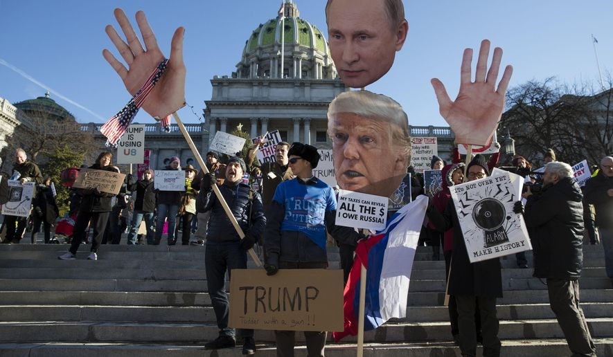 FILE - In this Dec. 19, 2016 file photo, protesters demonstrate ahead of Pennsylvania's 58th Electoral College at the state Capitol in Harrisburg, Pa. After the election that saw the winner of the popular vote fall short of the U.S. presidency, legislators in states including Connecticut, Pennsylvania, Ohio and New Mexico said they plan to introduce legislation that would require their state's Electoral College voters cast ballots for the presidential candidate who earns the most votes nationwide, regardless of the statewide results. (AP Photo/Matt Rourke, File)
