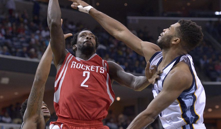 Houston Rockets guard Patrick Beverley (2) shoots between Memphis Grizzlies forward Jarell Martin, left, and guard Andrew Harrison during the first half of an NBA basketball game Friday, Dec. 23, 2016, in Memphis, Tenn. (AP Photo/Brandon Dill)