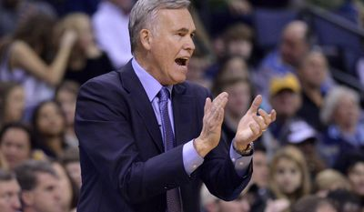 Houston Rockets coach Mike D'Antoni applauds during the first half of the team's NBA basketball game against the Memphis Grizzlies on Friday, Dec. 23, 2016, in Memphis, Tenn. (AP Photo/Brandon Dill)
