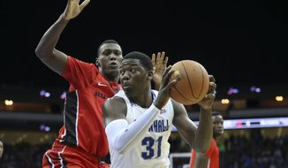 Seton Hall forward Angel Delgado (31) looks to take a shot as Rutgers forward Shaquille Doorson defends during the first half of an NCAA college basketball game Friday, Dec. 23, 2016, in Newark, N.J. (AP Photo/Mel Evans)