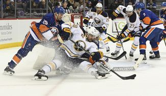 Buffalo Sabres left wing William Carrier (48) is guarded by New York Islanders left wing Jason Chimera (25) during the second period of an NHL hockey game in New York, Friday, Dec. 23, 2016. (Kathleen Malone-Van Dyke/Newsday via AP) /Newsday via AP)