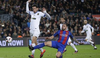 FC Barcelona's Paco Alcacer, right, duels for the ball during the Copa del Rey, Spain's King's Cup soccer match between FC Barcelona and Hercules at the Camp Nou in Barcelona, Spain, Wednesday, Dec. 21, 2016. (AP Photo/Manu Fernandez)