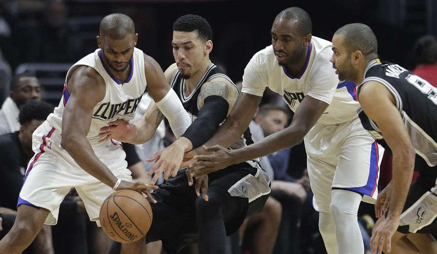 Los Angeles Clippers' Chris Paul, left, and Luc Richard Mbah a Moute, second from right, vie for the ball with San Antonio Spurs' Danny Green and Tony Parker, right, during the first half of an NBA basketball game Thursday, Dec. 22, 2016, in Los Angeles. (AP Photo/Jae C. Hong)