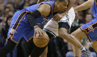 Oklahoma City Thunder guard Russell Westbrook, left, drives against Boston Celtics guard Avery Bradley in the first half of an NBA basketball game, Friday, Dec. 23, 2016, in Boston. (AP Photo/Elise Amendola)