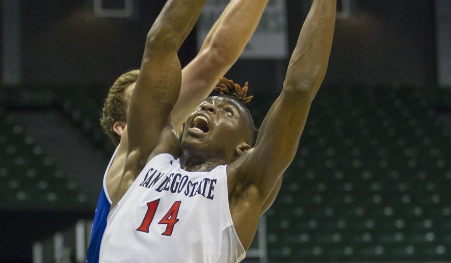 San Diego State forward Zylan Cheatham (14) battles Tulsa forward Will Magnay, back, for a rebound during the first half of an NCAA college basketball game at the Diamond Head Classic, Friday, Dec. 23, 2016, in Honolulu. (AP Photo/Eugene Tanner)