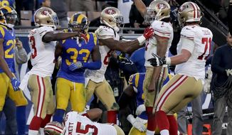 San Francisco 49ers quarterback Colin Kaepernick, second from right, celebrates after scoring a two-point conversion during the second half of an NFL football game against the Los Angeles Rams, Saturday, Dec. 24, 2016, in Los Angeles. (AP Photo/Rick Scuteri)