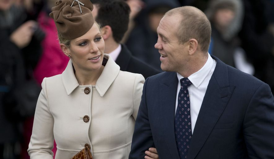 This is a Tuesday, Dec. 25, 2012, file photo of Britain's Queen Elizabeth II's granddaughter Zara Phillips and her husband rugby player Mike Tindall as they arrive for the British royal family's traditional Christmas Day church service in Sandringham, England. Officials say Queen Elizabeth II's granddaughter, Zara Tindall, has suffered a miscarriage, it was reported on Saturday, Dec. 24, 2016. She and her husband, retired rugby player Mike Tindall, had been expecting their second child. The pregnancy was announced last month. (AP Photo/Matt Dunham, File)