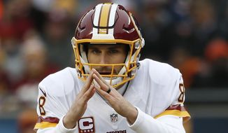 Washington Redskins quarterback Kirk Cousins (8) signals against the Chicago Bears during the first half of an NFL football game, Saturday, Dec. 24, 2016, in Chicago. (AP Photo/Nam Y. Huh)