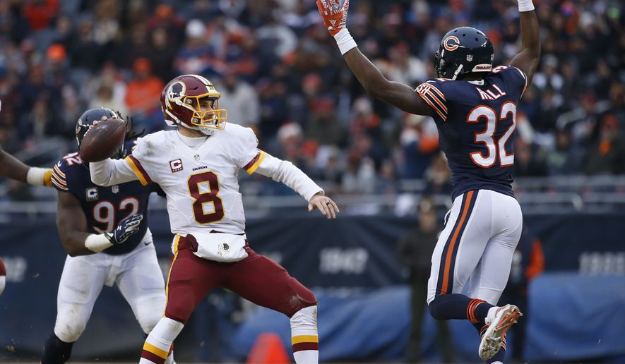 Washington Redskins quarterback Kirk Cousins (8) throws under pressure from Chicago Bears cornerback Deiondre' Hall (32) during the second half of an NFL football game, Saturday, Dec. 24, 2016, in Chicago. (AP Photo/Nam Y. Huh)