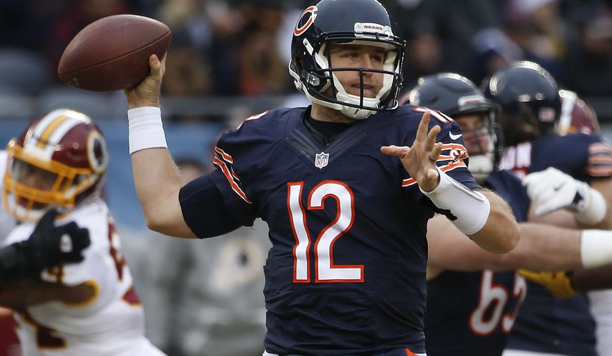 Chicago Bears quarterback Matt Barkley (12) throws against the Washington Redskins during the first half of an NFL football game, Saturday, Dec. 24, 2016, in Chicago. (AP Photo/Nam Y. Huh)