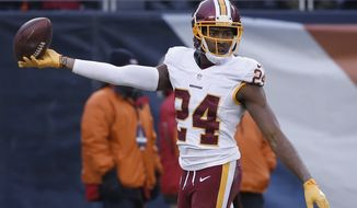 Washington Redskins cornerback Josh Norman (24) celebrates his interception against the Chicago Bears during the second half of an NFL football game, Saturday, Dec. 24, 2016, in Chicago. (AP Photo/Charles Rex Arbogast)