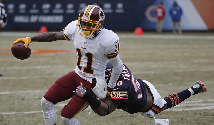 Washington Redskins wide receiver DeSean Jackson (11) runs after a catch as Chicago Bears inside linebacker Jerrell Freeman (50) makes the tackle during the first half of an NFL football game, Saturday, Dec. 24, 2016, in Chicago. (AP Photo/Charles Rex Arbogast)