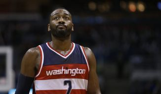 Washington Wizards' John Wall during the second half of an NBA basketball game against the Milwaukee Bucks Friday, Dec. 23, 2016, in Milwaukee. (AP Photo/Aaron Gash)