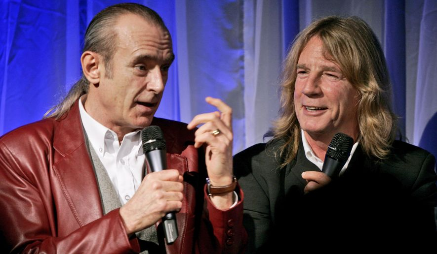 FILE - In this file photo dated Wednesday Oct. 26, 2005, showing members of Status Quo, with Francis Rossi, left, and Rick Parfitt during the launch of a DVD to mark the 40th anniversary of the rock band in London. Status Quo guitarist Rick Parfitt has died in Spain at age 68, according to a statement released by his manager Simon Porter, Saturday Dec. 24, 2016.  (AP Photo/Matt Dunham, FILE)
