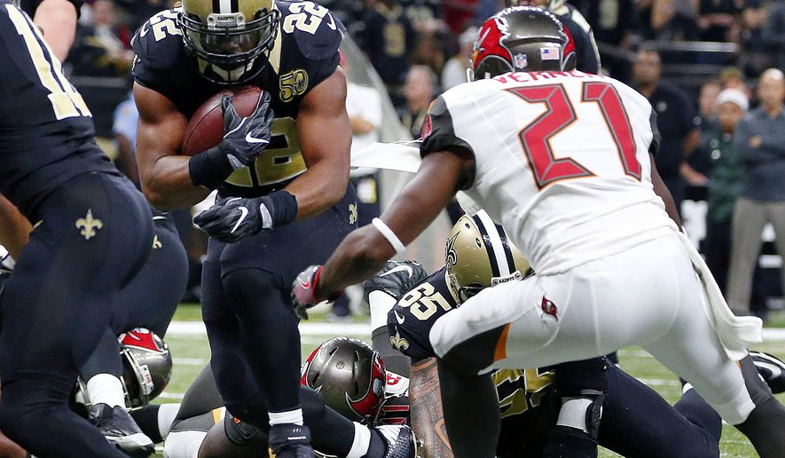 New Orleans Saints running back Mark Ingram (22) carries for a two-point conversion in the second half of an NFL football game against the Tampa Bay Buccaneers in New Orleans, Saturday, Dec. 24, 2016. (AP Photo/Butch Dill)