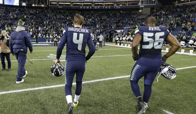Seattle Seahawks kicker Steven Hauschka (4) and middle linebacker Bobby Wagner (54) walk off the field after the Seahawks lost 34-31 to the Arizona Cardinals in an NFL football game, Saturday, Dec. 24, 2016, in Seattle.. (AP Photo/Ted S. Warren)
