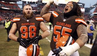 Cleveland Browns nose tackle Danny Shelton (55) and Jamie Meder (98) celebrate after a win over San Diego Chargers in an NFL football game, Saturday, Dec. 24, 2016, in Cleveland. (AP Photo/Ron Schwane)