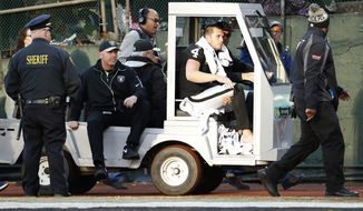Oakland Raiders quarterback Derek Carr (4) is taken off the field in a cart during the second half of an NFL football game against the Indianapolis Colts in Oakland, Calif., Saturday, Dec. 24, 2016. (AP Photo/Tony Avelar)