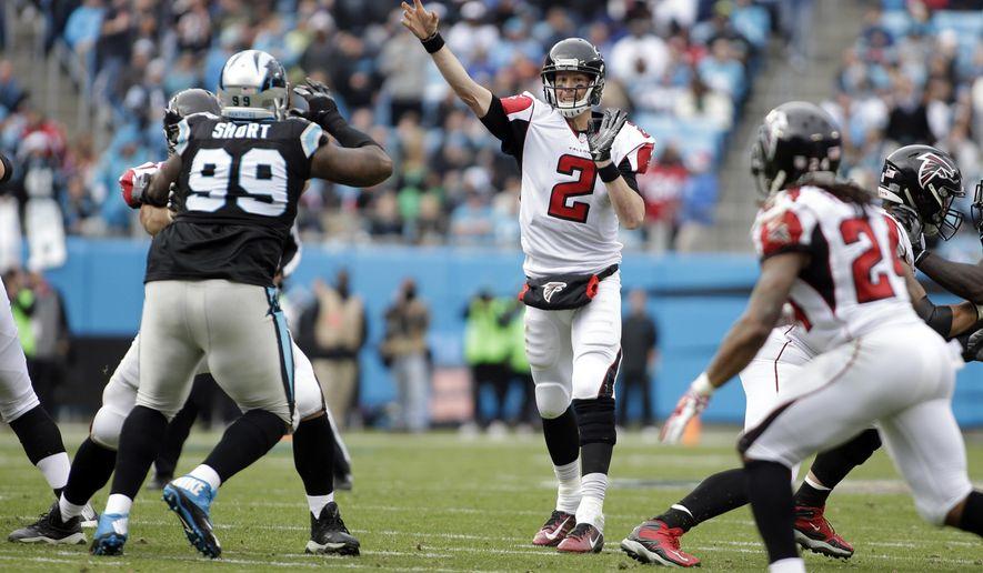 Atlanta Falcons' Matt Ryan (2) throws a pass as Carolina Panthers' Kawann Short (99) defends in the first half of an NFL football game in Charlotte, N.C., Saturday, Dec. 24, 2016. (AP Photo/Bob Leverone)