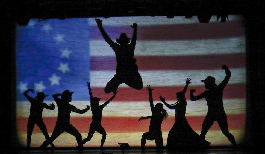 In this photo taken on Tuesday, Dec. 20, 2016, dancers of the U.S. company 'Catapult' perform during their show 'Magic Shadows', in Milan, Italy. Dancers in the company create shadow sculptures with their bodies, giving a contemporary twist to the ancient Chinese art of shadow theaters. (AP Photo/Luca Bruno)