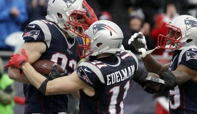 New England Patriots tight end Matt Lengel, left, celebrates his touchdown catch with Julian Edelman, center, and Malcolm Mitchell during the first half of an NFL football game against the New York Jets, Saturday, Dec. 24, 2016, in Foxborough, Mass. (AP Photo/Charles Krupa)