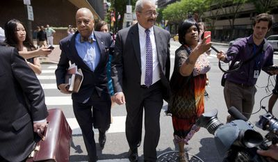FILE - In this June 21, 2016, file photo, Rep. Chaka Fattah, D-Pa., center, leaves the federal courthouse in Philadelphia. Fattah lost his re-election bid shortly before being convicted of using federal grants and nonprofit funds to repay an illegal loan to his failed mayoral campaign. (AP Photo/Matt Rourke, File)