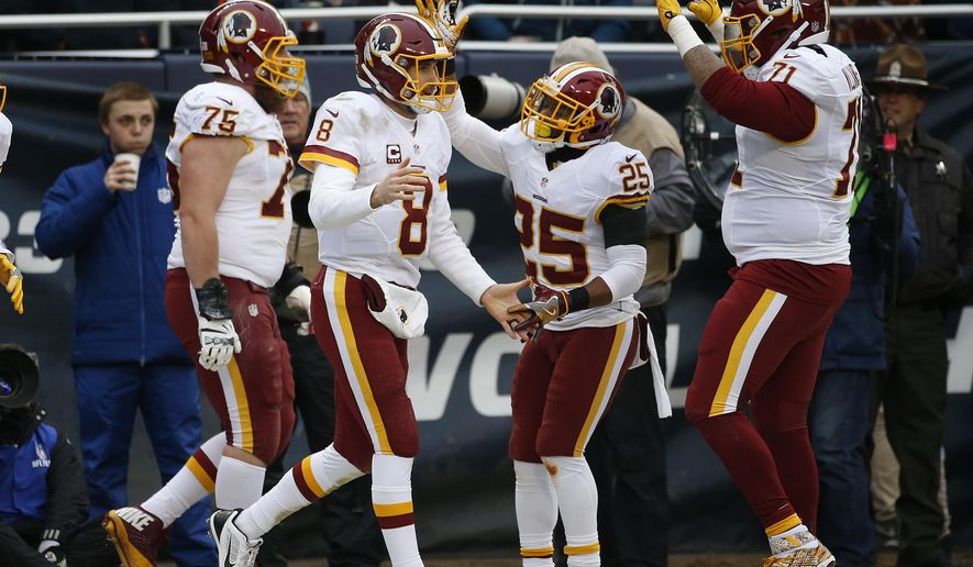 Washington Redskins quarterback Kirk Cousins (8) celebrates his nine-yard touchdown run against the Chicago Bears during the first half of an NFL football game, Saturday, Dec. 24, 2016, in Chicago. (AP Photo/Nam Y. Huh)
