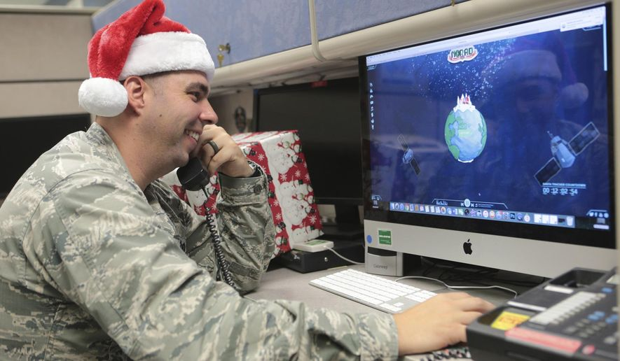 Maj. Jared Scott, makes sure NORAD's Santa tracker is working correctly at Tyndall Air Force Base on Friday, Dec. 23, 2016 in Panama City, Fla. (Heather Howard/News Herald via AP)