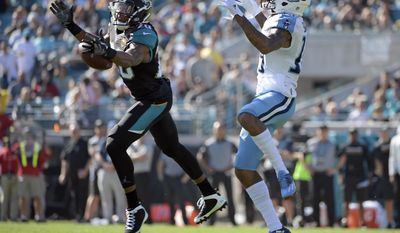 Jacksonville Jaguars cornerback Jalen Ramsey (20) breaks up a pass intended for Tennessee Titans wide receiver Tajae Sharpe, right, during the first half of an NFL football game, Saturday, Dec. 24, 2016, in Jacksonville, Fla. (AP Photo/Phelan M. Ebenhack)
