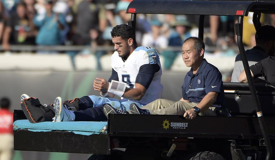 Tennessee Titans quarterback Marcus Mariota leaves the field on a cart after he was injured during the second half of an NFL football game against the Jacksonville Jaguars, Saturday, Dec. 24, 2016, in Jacksonville, Fla. (AP Photo/Phelan M. Ebenhack)