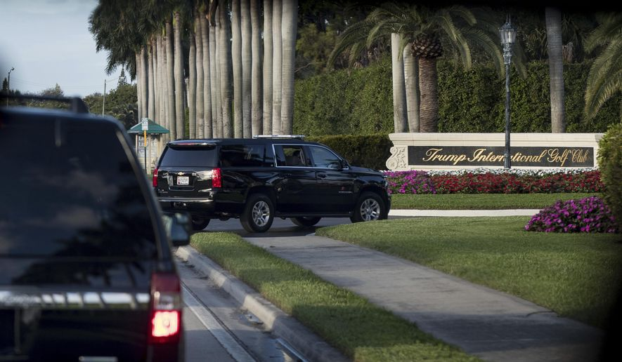 A motorcade carrying President-elect Donald Trump arrives at Trump International Golf Club, in West Palm Beach, Fla., Friday, Dec. 23, 2016. (AP Photo/Andrew Harnik)