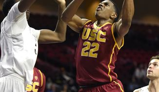 Southern California guard De'Anthony Melton (22) shoots against Wyoming during the first half of an NCAA college basketball game Friday, Dec. 23, 2016, in Las Vegas. (AP Photo/David Becker)