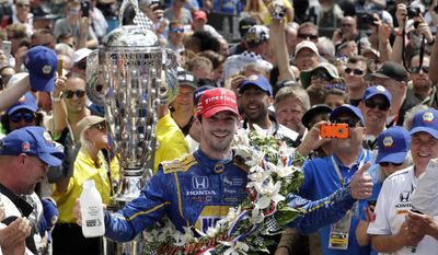 FILE - In this May 29, 2016 file photo, Alexander Rossi celebrates after winning the 100th running of the Indianapolis 500 auto race at Indianapolis Motor Speedway in Indianapolis. The race was snatched away by Alexander Rossi, a 24-year-old American competing in the race for the first time. (AP Photo/Darron Cummings, File)