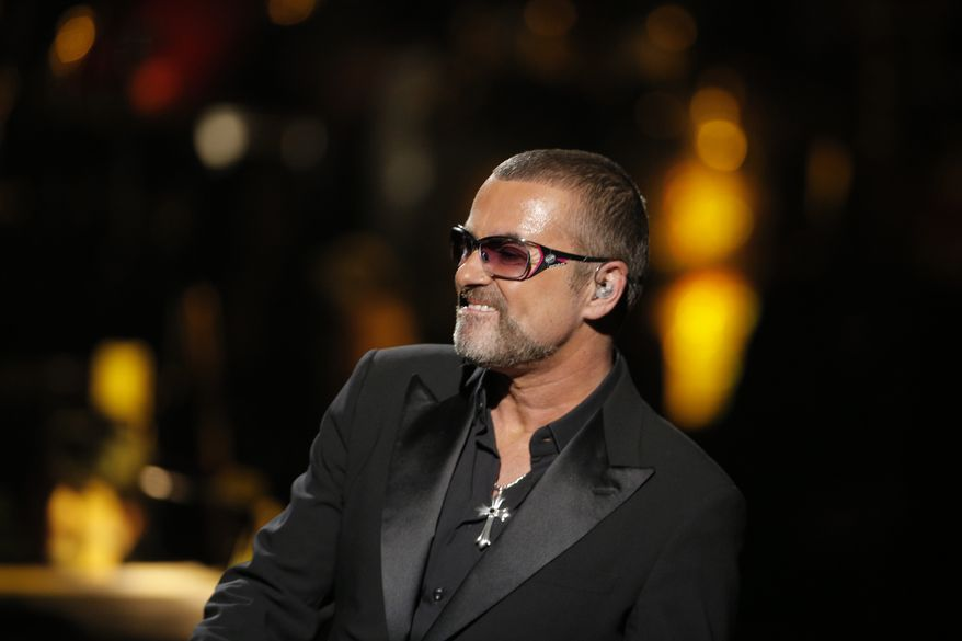 George Michael performs at a concert to raise money for AIDS charity Sidaction at Palais Garnier Opera house in Paris, France, on Sept. 9, 2012. (Associated Press)