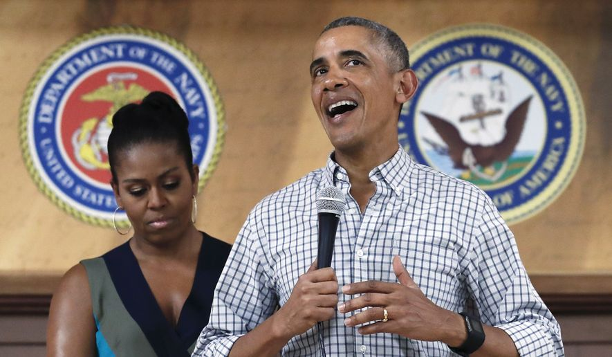 President Barack Obama, joined by first lady Michelle Obama, speaks during an event to thank service members and their families at Marine Corps Base Hawaii, in Kaneohe Bay, Hawaii, Sunday, Dec. 25, 2016. (AP Photo/Carolyn Kaster) ** FILE **